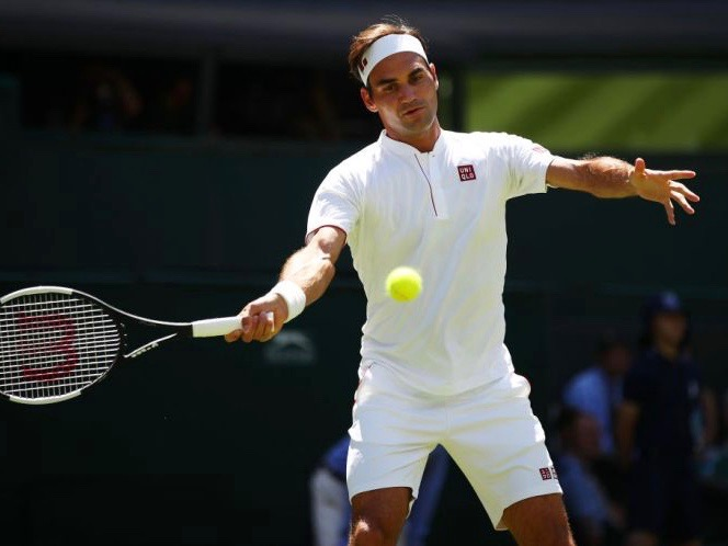 LONDON, ENGLAND - JULY 02:  Roger Federer of Switzerland returns to Dusan Lajovic of Serbia during their Men's Singles first round match on day one of the Wimbledon Lawn Tennis Championships at All England Lawn Tennis and Croquet Club on July 2, 2018 in London, England.  (Photo by Clive Brunskill/Getty Images)